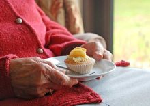 Elderly Hands Holding Cake